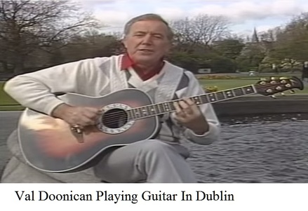 Val Doonican playing guitar