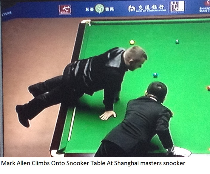 Mark Allen climbs onto snooker table at Shanghai Masters
