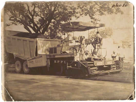 Machine laying hot asphalt on the road
