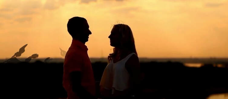 Silhouette of couple in love outdoor scene